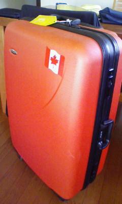 スーツケースと快